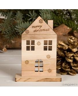 Figura silueta casita de madera.