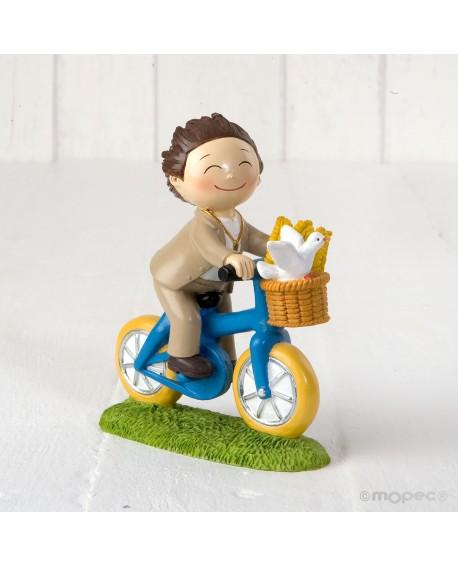 Figura de niño de comunión en bici