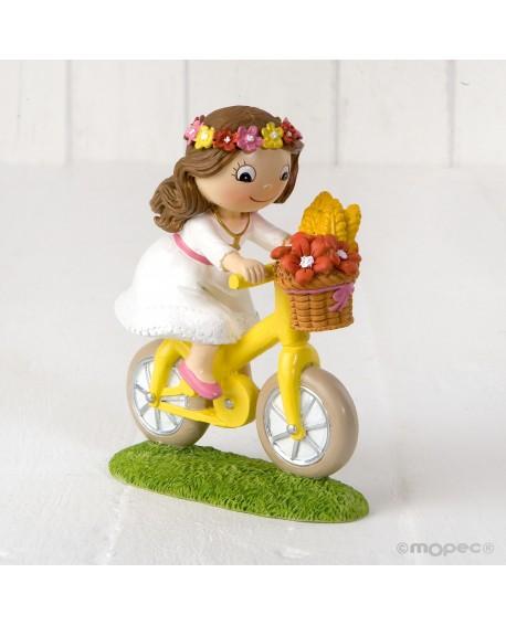 Figura de niña de comunión en bici