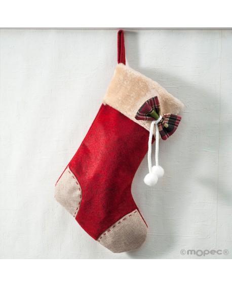 Calcetín de tela decorada con lazo.