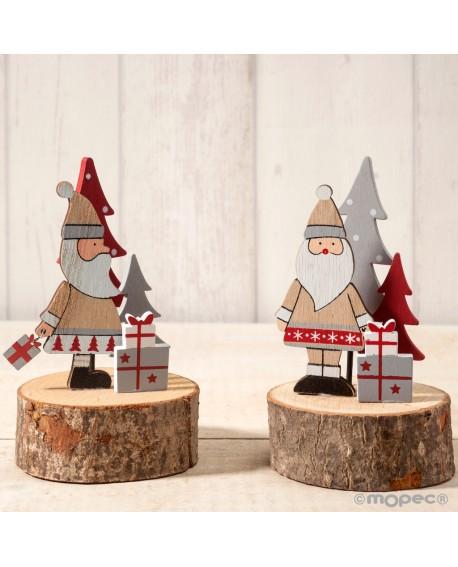 Figura de madera sobre tronco de Papa Noel
