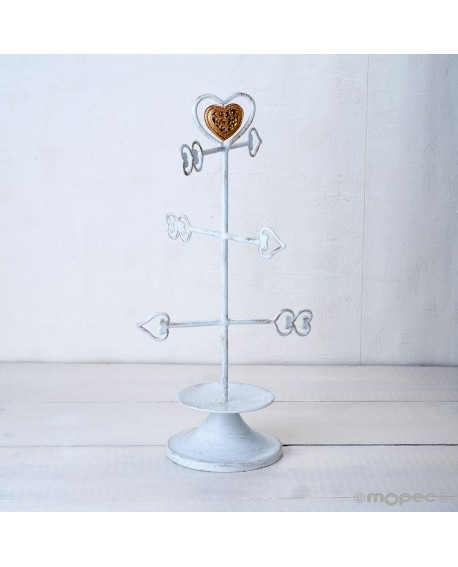 Joyero de metal con flechas de corazones.