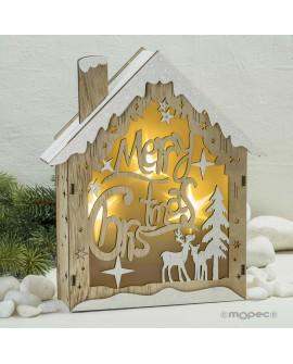 Casita de madera con siluetas con luz
