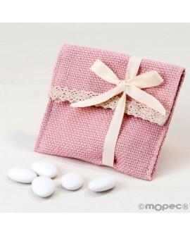 Bolsita de algodón en rosa con velcro con peladillas.