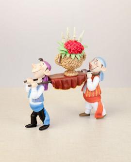 Falleros de ofrenda con flores